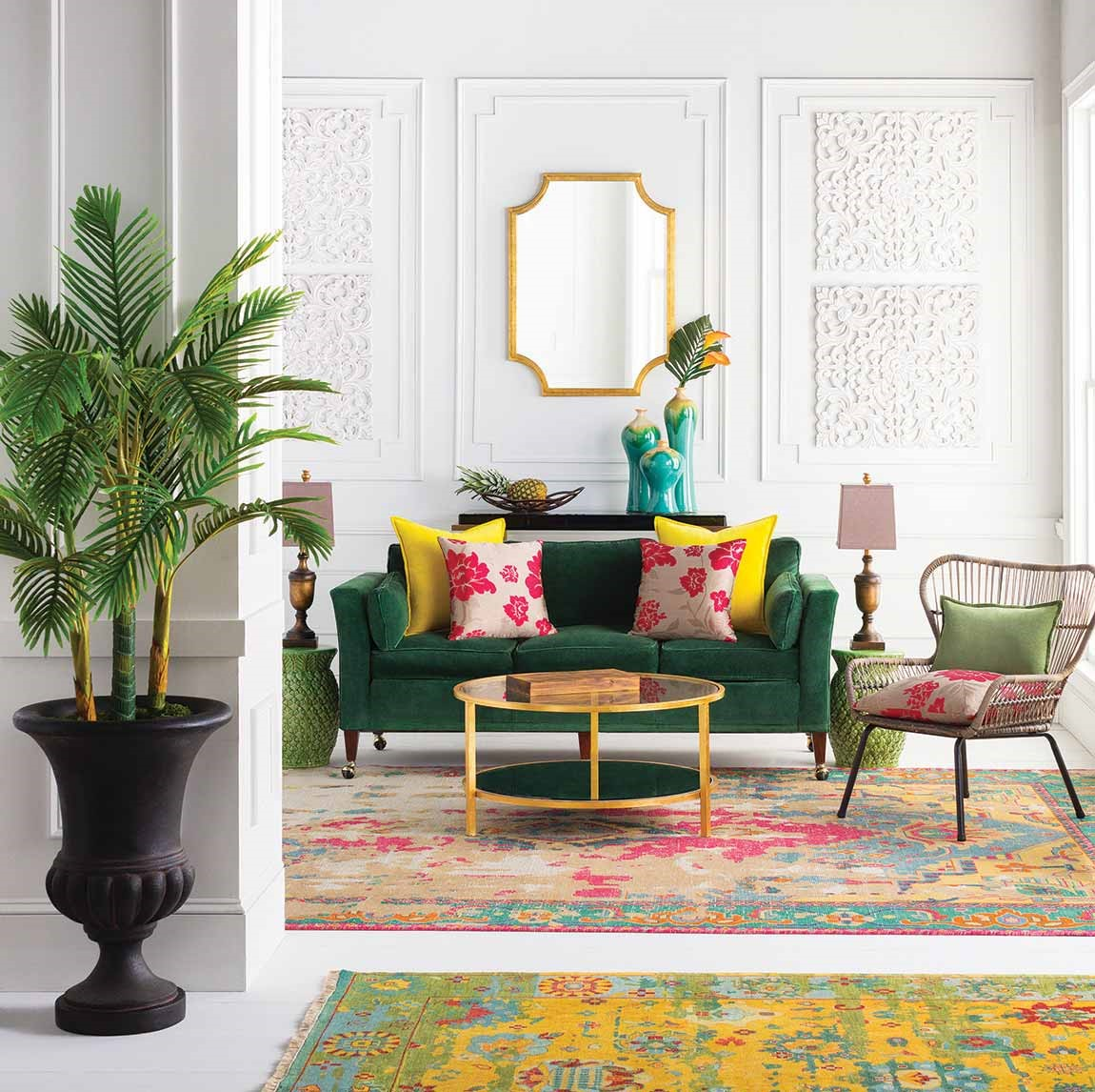 light colored living room with tropical plants-and prints